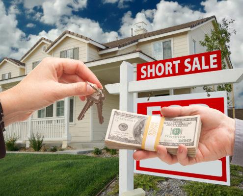 Handing Over Cash For House Keys And Short Sale Sign